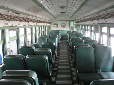[I found this passenger car very depressing—the seats are smaller than what you would find on an airplane!]
