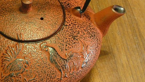 [Cast iron, baby!  I also like the rooster motif, as it matches early American folk art.]