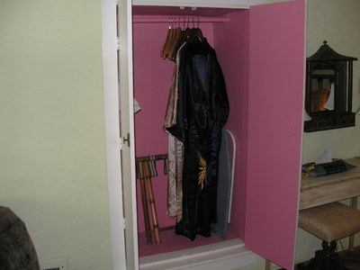 [Complimentary bathrobes in the pinkest closet I've ever seen]