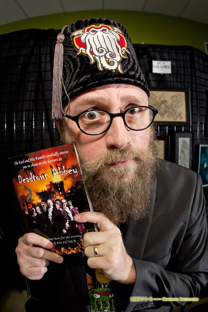 [The book, the beard, the fez. The Hoade]