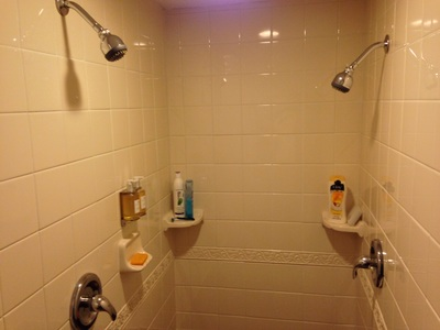[His-n-hers shower heads. How sweet!]