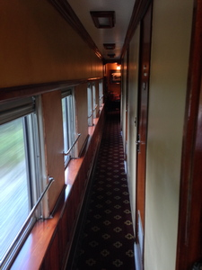[Three staterooms to the right, and the dining room at the far end.  There's quite a bit packed into a 74′ train car.]