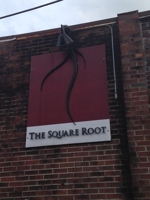 [I think they wanted to call the place 1.732050807568877, but that was just too long to use on a sign.  Also, those roots aren't square.]