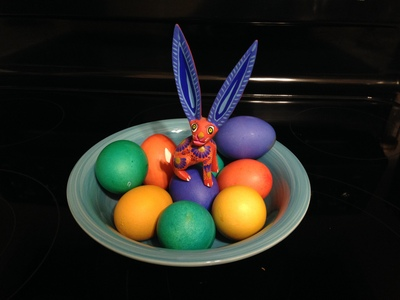 [This is the colorful Osterhase which brings forth a bounty of colorful eggs, not to be confused with the golden brown Hasenpfeffer, which is brought forth with onions and a marinade of wine and vinegar.]