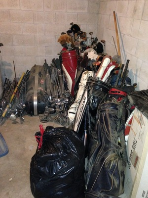 [There's at least a dozen golf bags full of golf clubs, plus piles of golf clubs.]