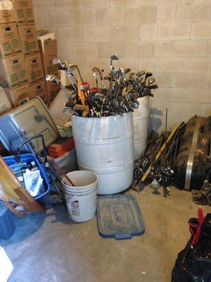 [A barrel full of golf clubs—what fun!]