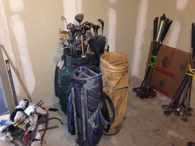 [Four golf club bags, plus a few loose drivers.  If only this was the extent of the problem.  If only … ]