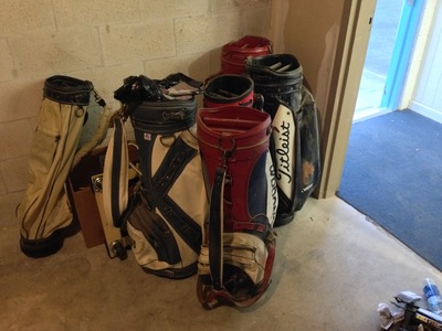 [Empty golf bags.  We do have enough to open up a store, don't we?  Thank God that's the last of it.  Sheesh!]