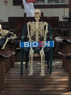 [A skeleton holding a BIDEN sign—yeah, I guess he has a few bones to pick with Biden.]